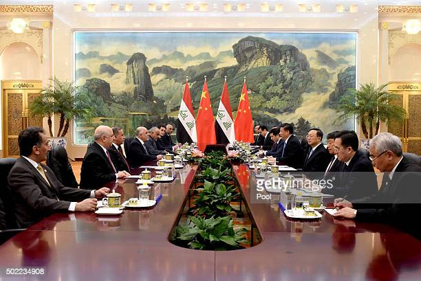 Chinese President Xi Jinping meets with Iraqi Prime Minister Haider alAbadi at the Great Hall of the People on December 222015 in Beijing China...