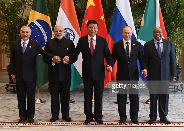 Chinese President Xi Jinping takes a group photo with Indian Prime Minister Narendra Modi Brazil's President Michel Temer Russian President Vladimir...