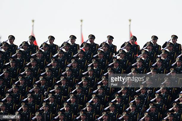Chinese soldiers salute in a chorus at a stage during a military parade at Tiananmen Square a military parade to mark the 70th anniversary of the end...