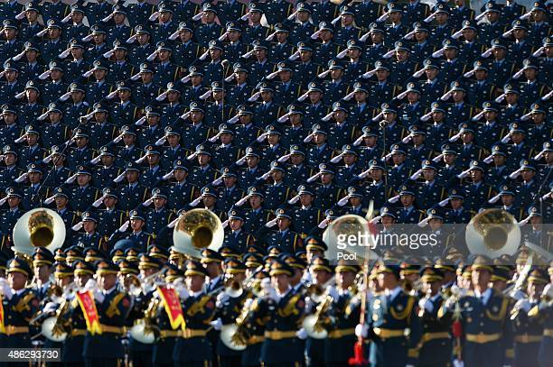 Chinese soldiers salute in a chorus at a stage during a military parade to mark the 70th anniversary of the end of World War Two on September 3, 2015...