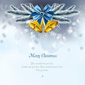 Christmas Background. Golden Bells and Christmas Tree Branches.
