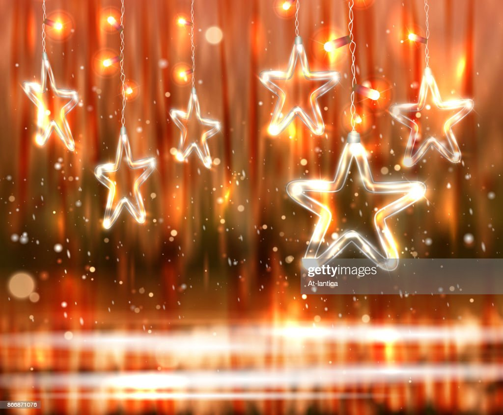 Christmas background of de-focused lights with decorated Glass Stars