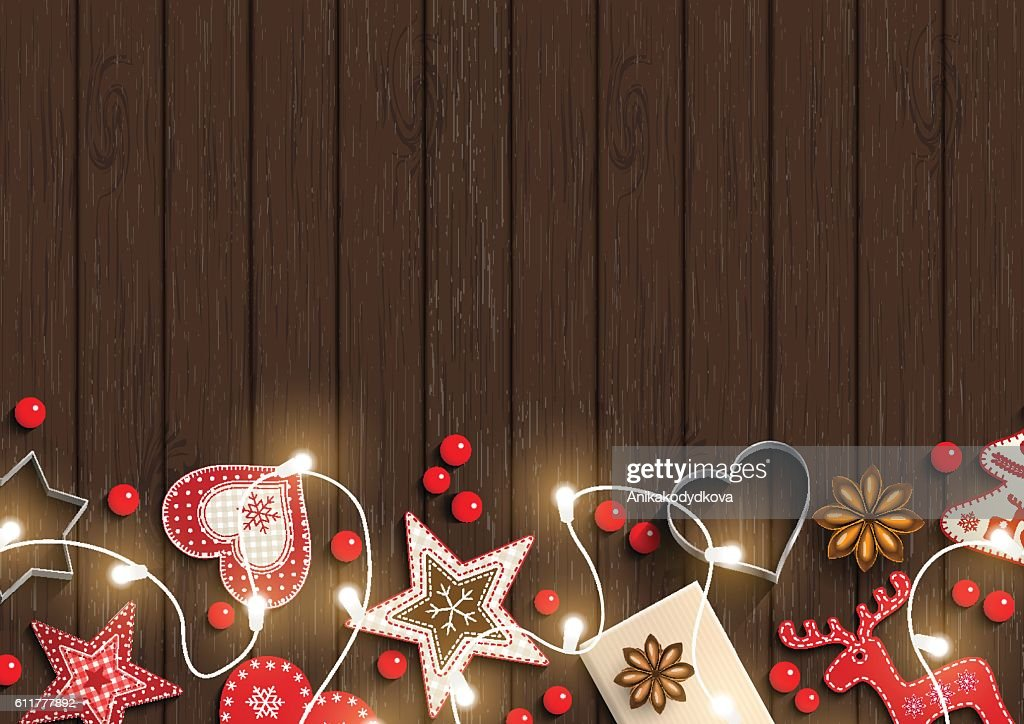 Christmas background, small scandinavian styled decorations lying on dark brown