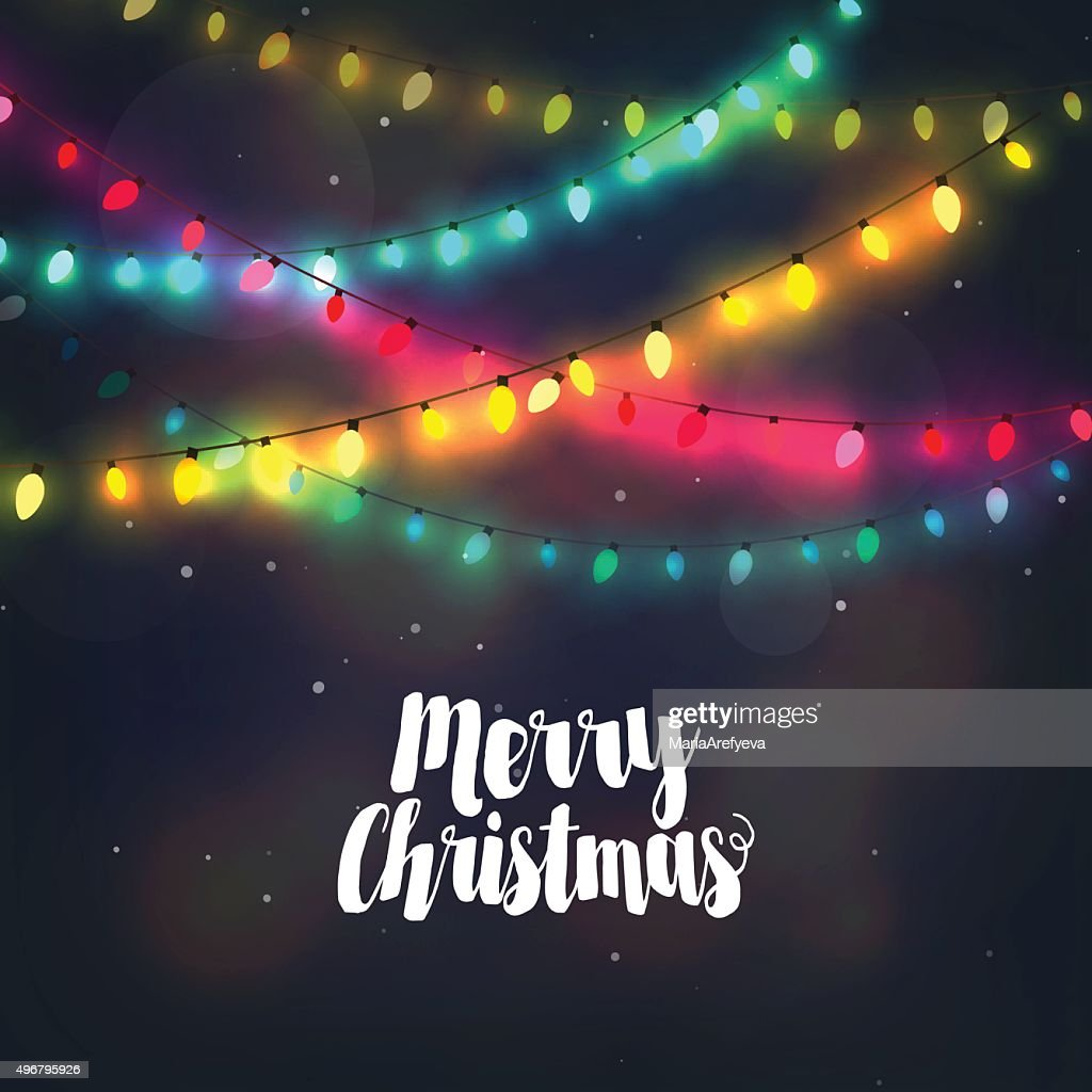 Christmas background with colorful light garlands and Merry Christmas lettering