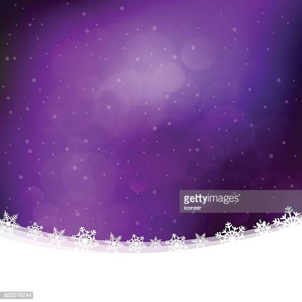 Christmas background with purple lilac snowing winter sky and landscape