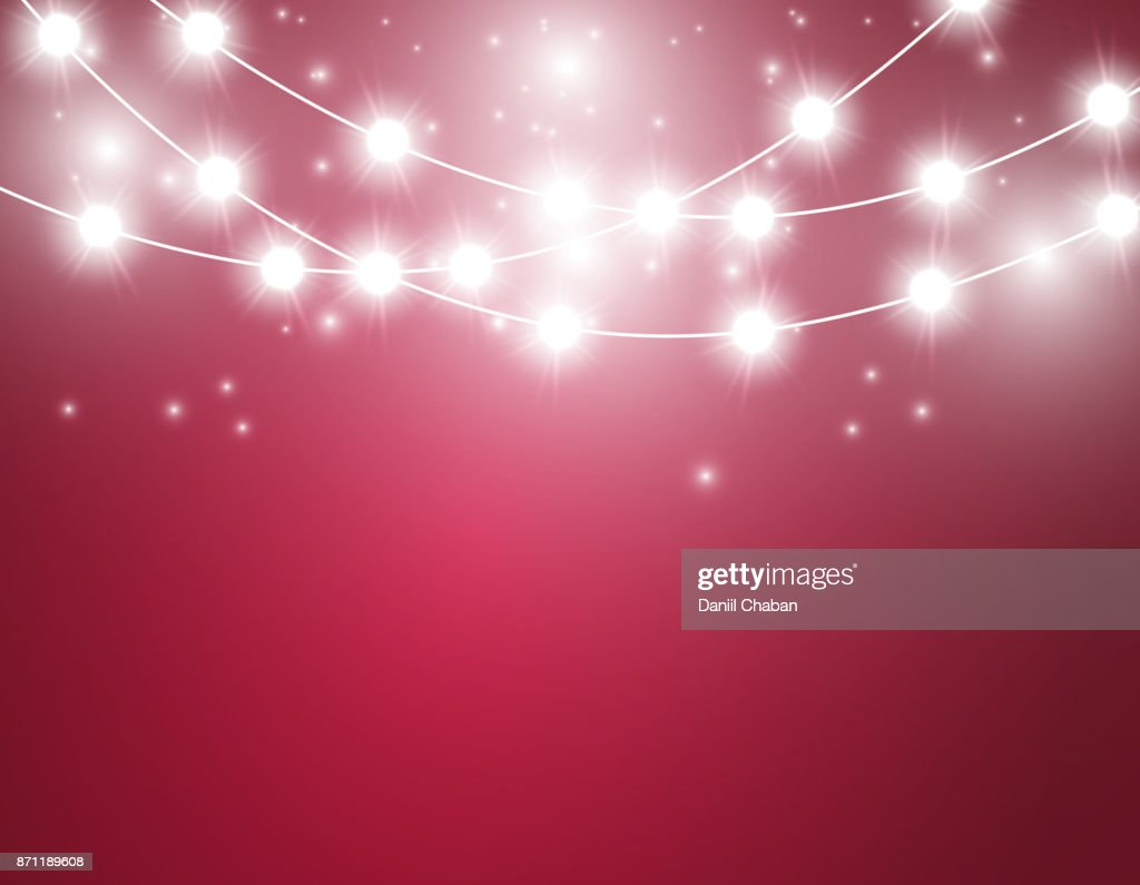 Christmas background with xmas lights. Vector glowing garland isolated on red background with shine particles