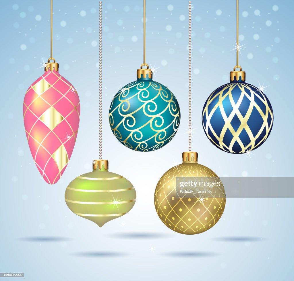 Christmas balls ornaments hanging on gold thread.