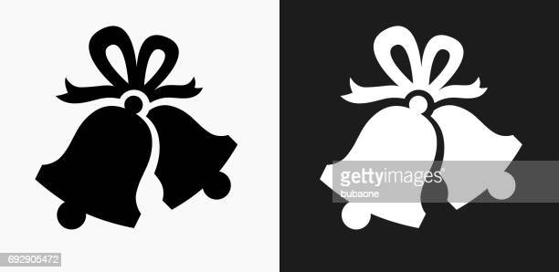 christmas bells icon on black and white vector backgrounds - bell stock illustrations