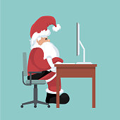 Christmas card of Santa Claus on his computer