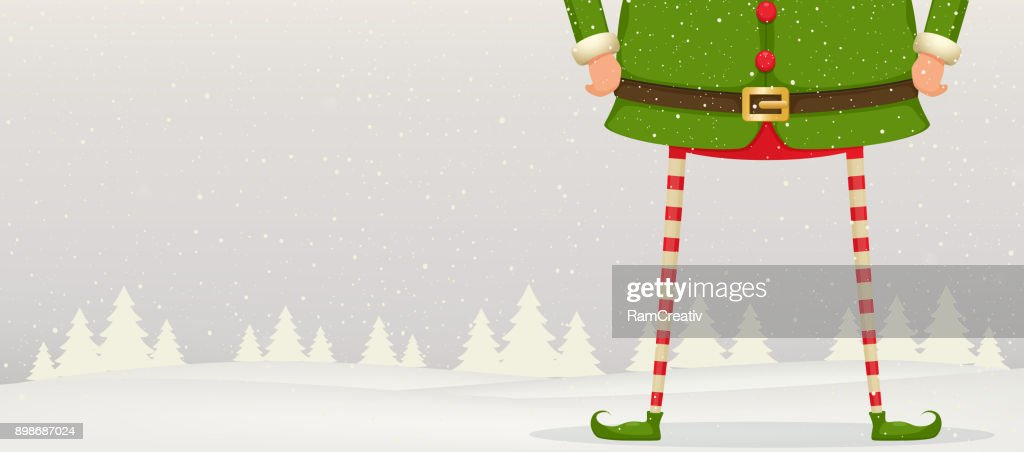 Christmas composition of feet and hands of Elf standing in the snow . Festive New Year background.