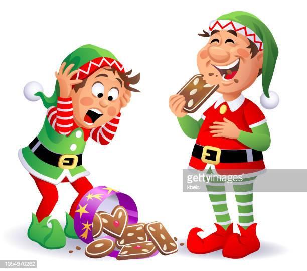 ilustraciones, imágenes clip art, dibujos animados e iconos de stock de elfos de navidad con galletas de jengibre - galletas navidad