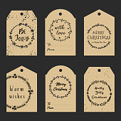 Christmas gift tags with hand drawn wreath and lettering. Decorative garlands with calligraphy. Vector printable tags.