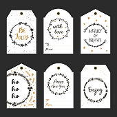 Christmas gift tags with hand drawn wreath and lettering. Decorative garlands with calligraphy Happy New Year, Be Jolly, Merry & Bright, With love, Enjoy, Ho ho ho. Vector printable tags.