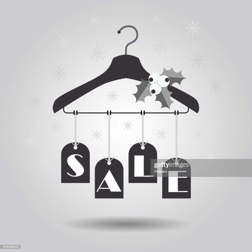 Christmas Holiday hanging SALE tags on clothing hanger with mistletoe decoration icons on gray gradient background