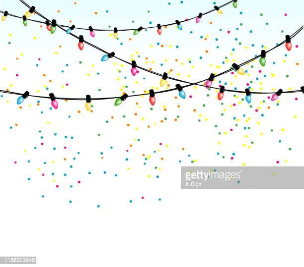 christmas lights and confetti background - christmas lights stock illustrations