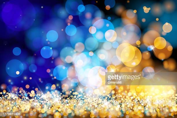 christmas lights defocused background - gold blue bokeh - dark blue stock illustrations