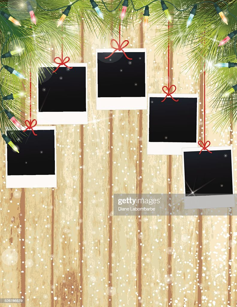 Christmas Lights Evergreen Background Polaroids On Wood