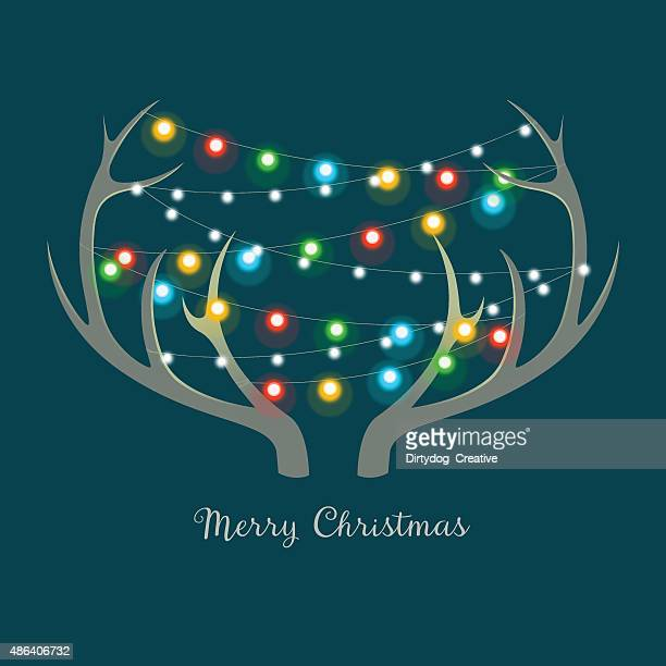 christmas lights on antlers - antler stock illustrations