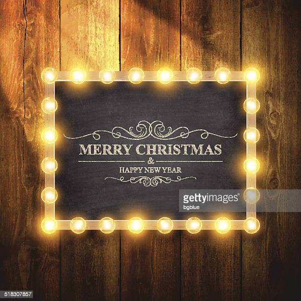 christmas lights on chalkboard and wooden wall - lighting equipment stock illustrations, clip art, cartoons, & icons
