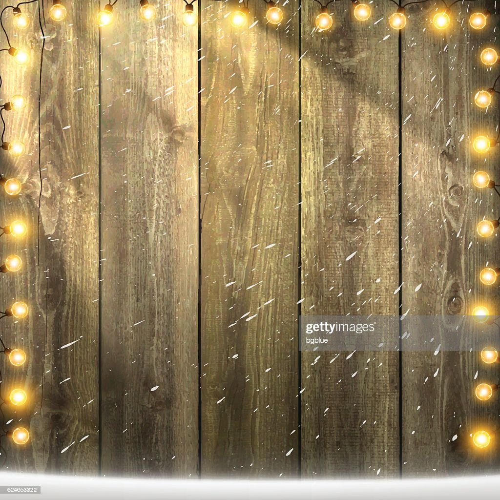 Christmas Lights On Lit Blank Wooden Background With Snow Vector Art
