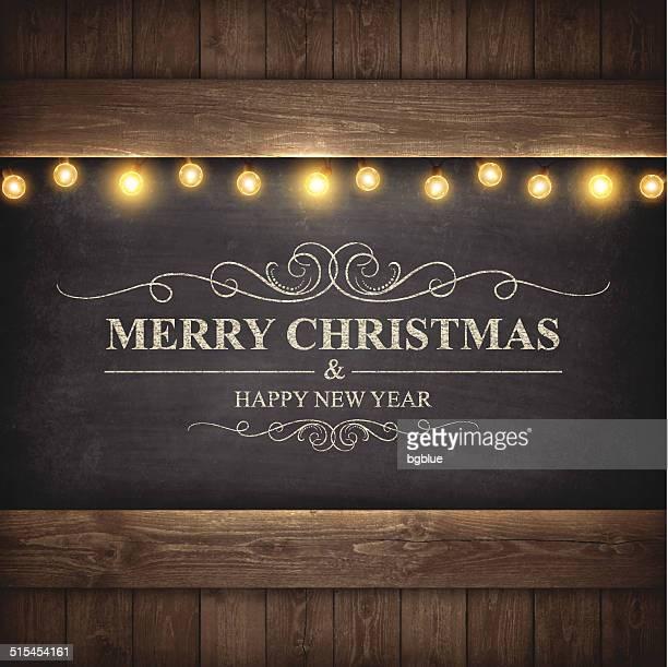 christmas lights on wooden boards and chalkboard - hardwood floor stock illustrations, clip art, cartoons, & icons