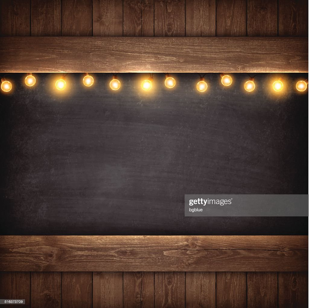 Christmas Lights on Wooden Boards and Chalkboard : stock illustration