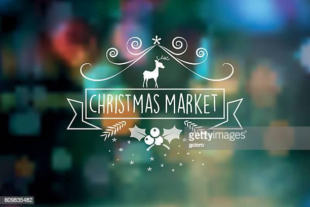 christmas market vintage badge on blurred lights