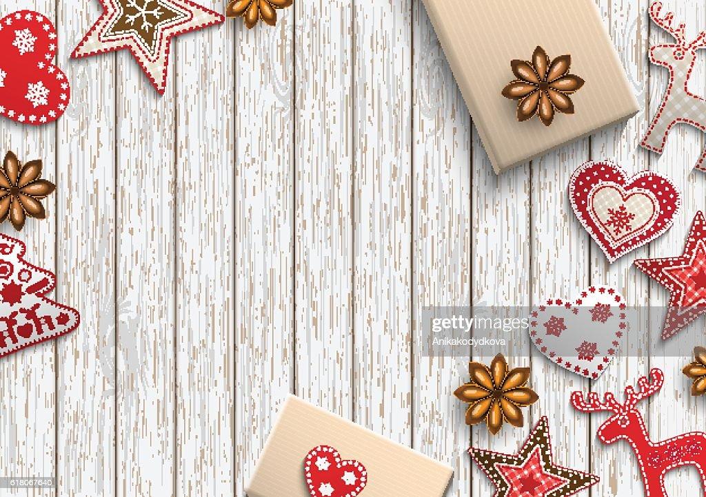 Christmas motive, small scandinavian styled decorations lying on wooden desk