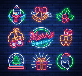 Christmas neon signs. Vector illustration on winter holidays. Neon luminous symbols for New Year and Christmas projects greetings cards, posters, banners, flyers. Neon signboards, vibrant advertising