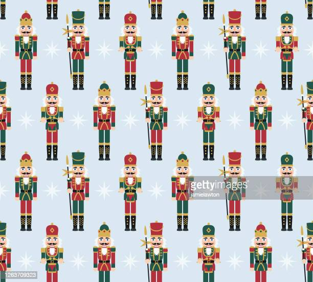 christmas nutcracker figures - seamless pattern with toy soldier doll decorations - military uniform stock illustrations
