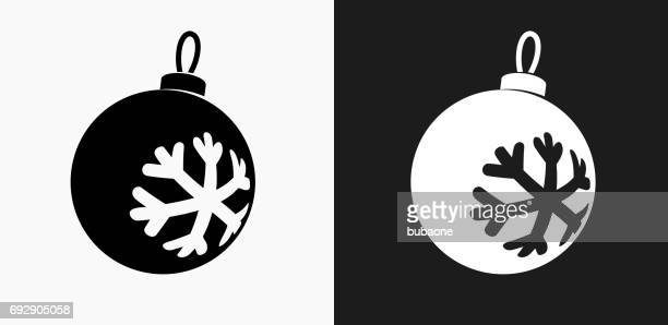 christmas ornament icon on black and white vector backgrounds - christmas ornament stock illustrations