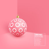 Christmas pink bauble with geometric pattern. 3d realistic style on wall background, vector illustration.