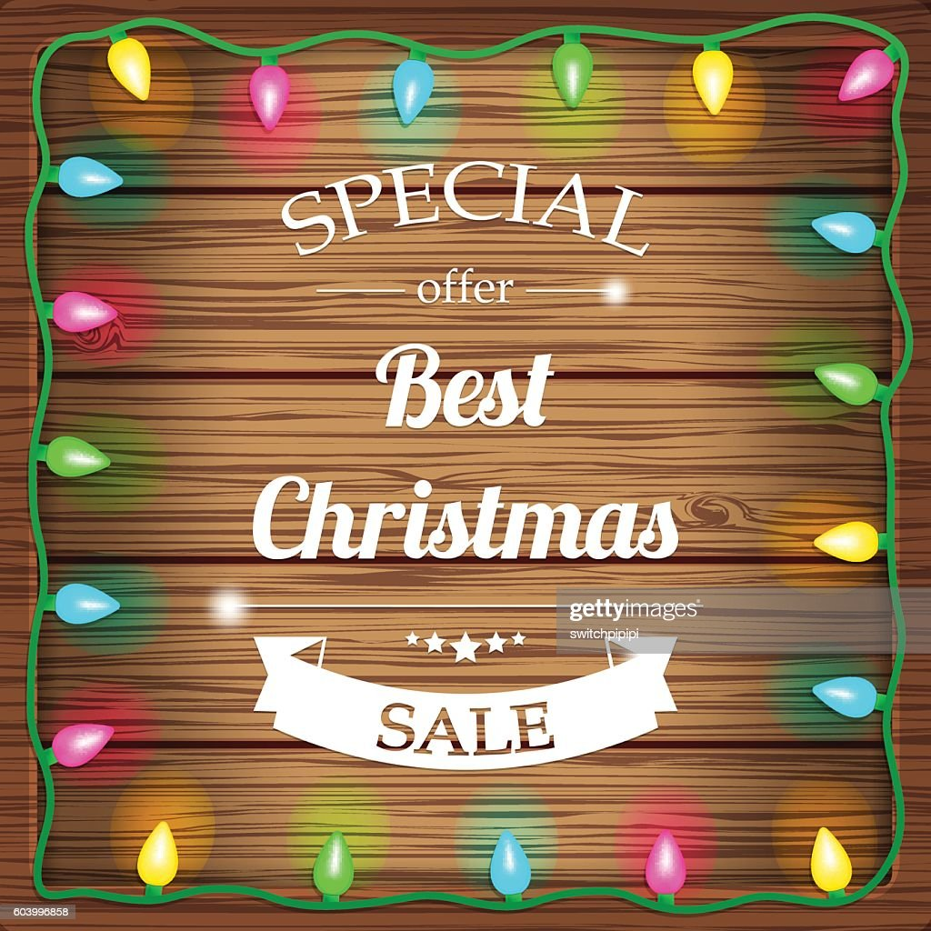 Christmas sale on wooden background with christmas lights. Vector