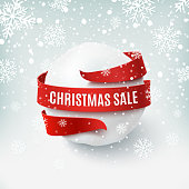 Christmas sale, snow ball with red bow and ribbon around.