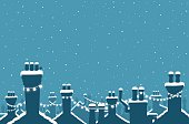 Christmas snow covered chimneys strung with lights