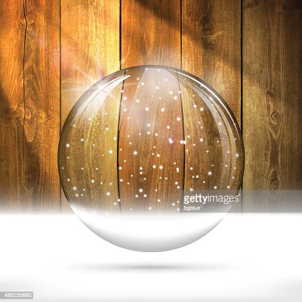 Christmas snow globe on Wooden Background