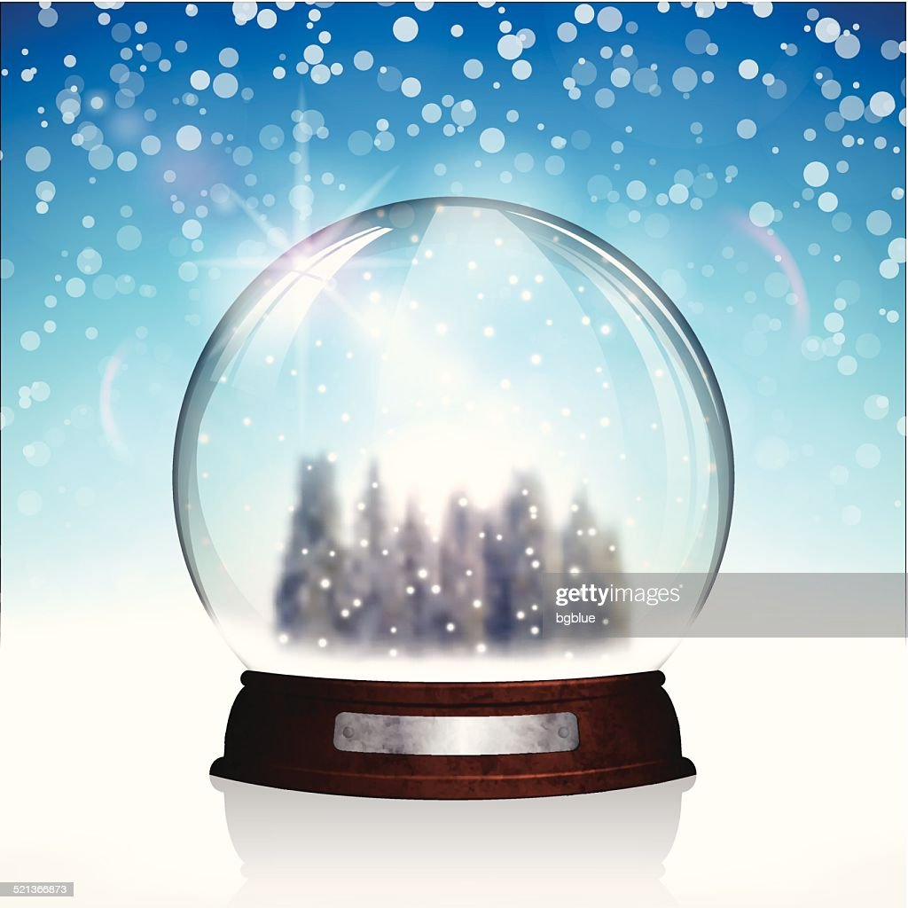Christmas snow globe with christmas trees on bright blue Background