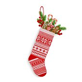 Christmas stocking with sweets and gifts in Scandinavian style isolated on white