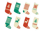 Christmas stockings. Various traditional colorful and ornate holiday stockings or socks collection. Cartoon New Year vector eps 10 illustration isolated on white background in a flat style.