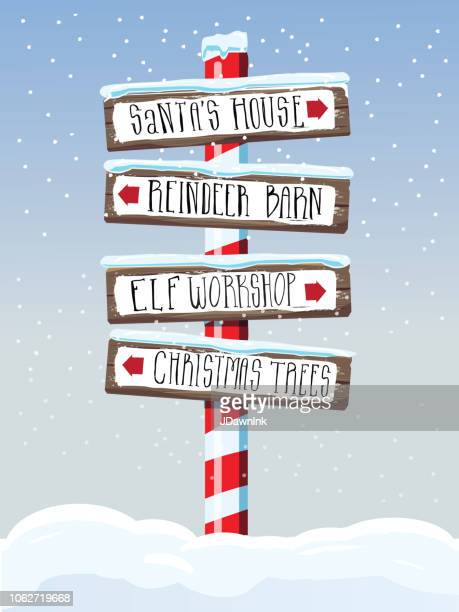 christmas themed wooden winter sign with hand lettered text - directional sign stock illustrations
