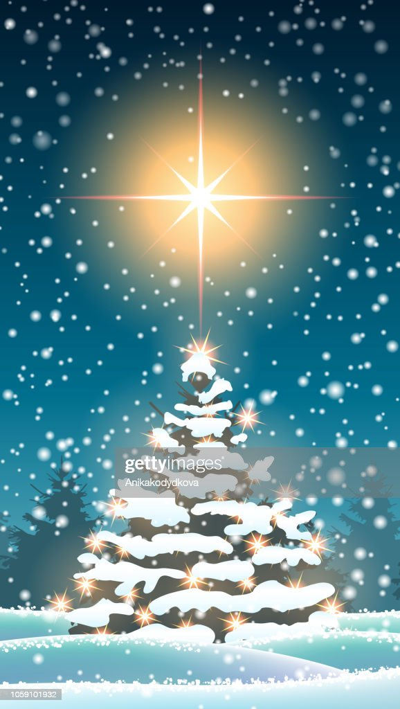 Christmas tree in winter landscape with big star