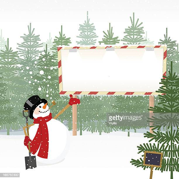 Christmas trees for sale and snowman with billboard