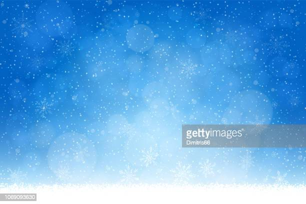 christmas - winter blue background: falling snow, snowflakes and defocused lights - winter stock illustrations