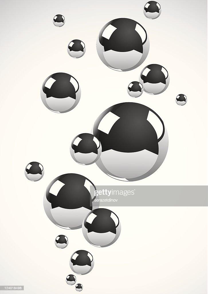 Chrome metal balls floating on off white background