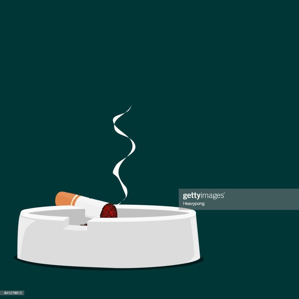 Cigarette on teal background