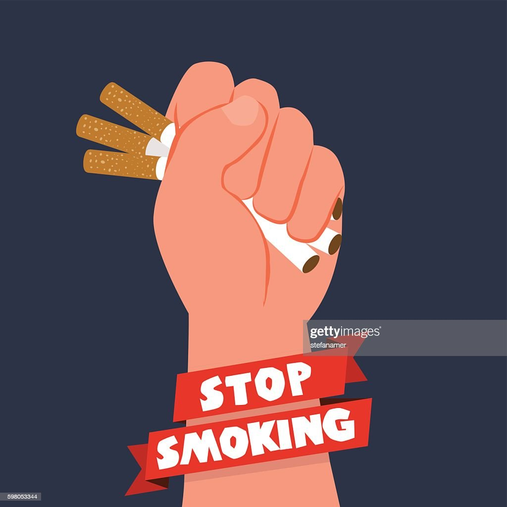 Cigarettes in fist hand. giving up smoking. stop smoking concept