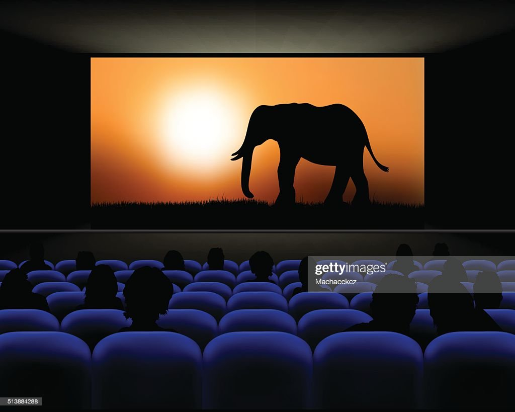 Cinema hall with rows of seats and screen with movie