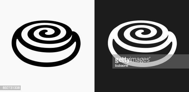 cinnamon bun icon on black and white vector backgrounds - bun bread stock illustrations, clip art, cartoons, & icons