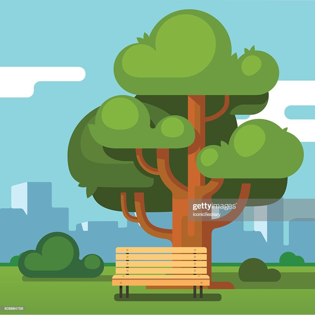 City park bench under an oak with urban landscape