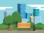 City park with bench and downtown skyscrapers